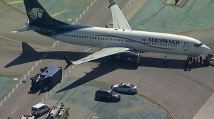 Plane Collides with Truck at International Airport, Injuring 8 People